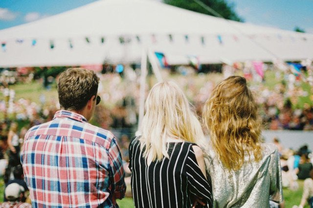 three friends attending a summer outdoor event